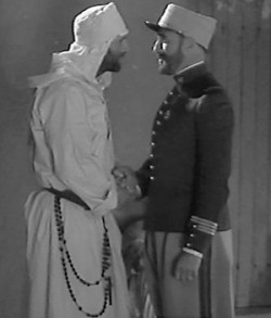 "Father de Foucauld and Major Laperrine as portrayed in the film ""The Call of Silence."""