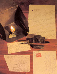 A lamp and a writing case made by Father de Foucauld.